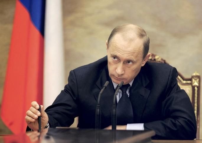 Nhìn lại Tổng thống Putin sau gần 2 thập kỷ nắm quyền - Ảnh 10.