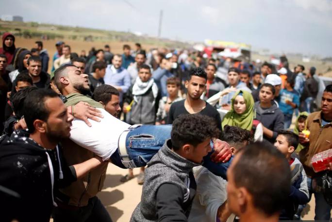 Đụng độ đẫm máu ở Dải Gaza, hơn 1.000 người thương vong - Ảnh 5.