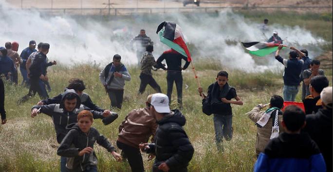 Đụng độ đẫm máu ở Dải Gaza, hơn 1.000 người thương vong - Ảnh 4.