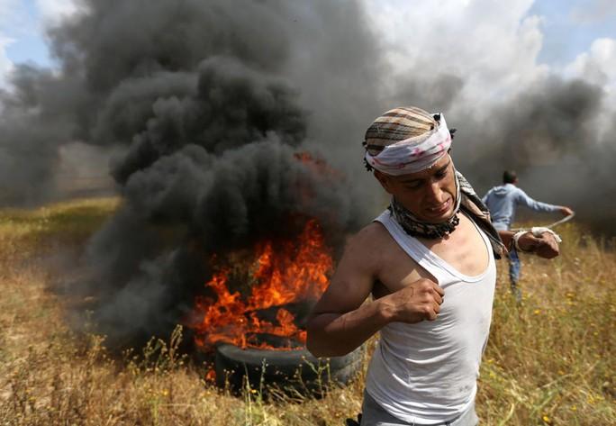 Ngày đẫm máu ở Gaza, Israel không ngần ngại bắn đạn thật - Ảnh 5.