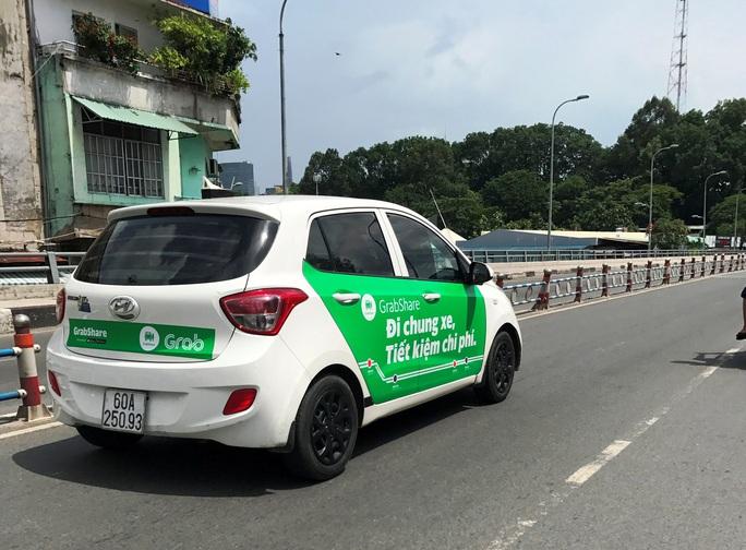 Grab, Uber nói gì sau ý kiến của Bộ trưởng GTVT? - Ảnh 1.