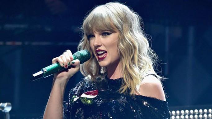 Taylor Swift gây tranh luận vì trở lại công chúa đồng quê - Ảnh 1.