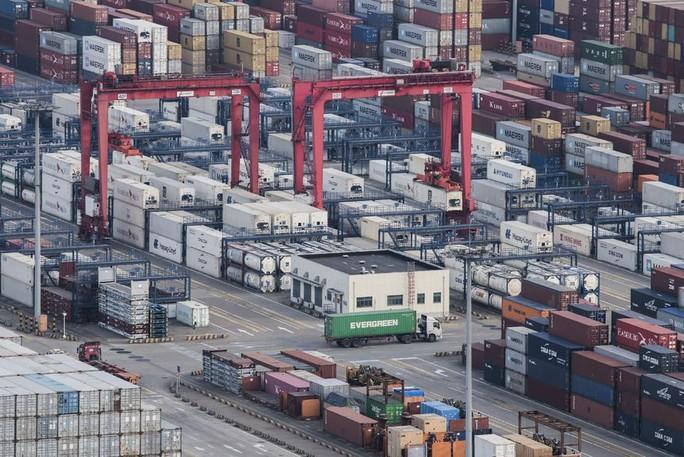 Trung Quốc bắt đầu đáp trả thương mại Mỹ - Ảnh 1.