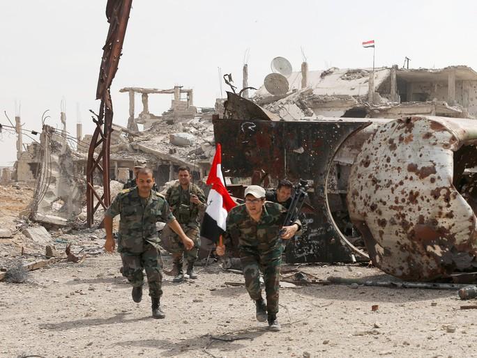 Quân đội Syria siết vòng vây quanh trại tị nạn Palestine - Ảnh 1.