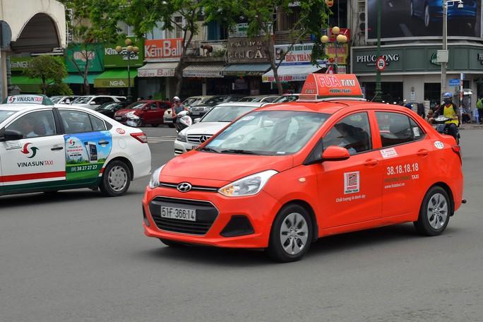 Taxi công nghệ vào cuộc chiến mới - Ảnh 1.