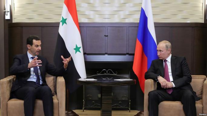 Ông Assad bất ngờ tới Nga - Ảnh 1.