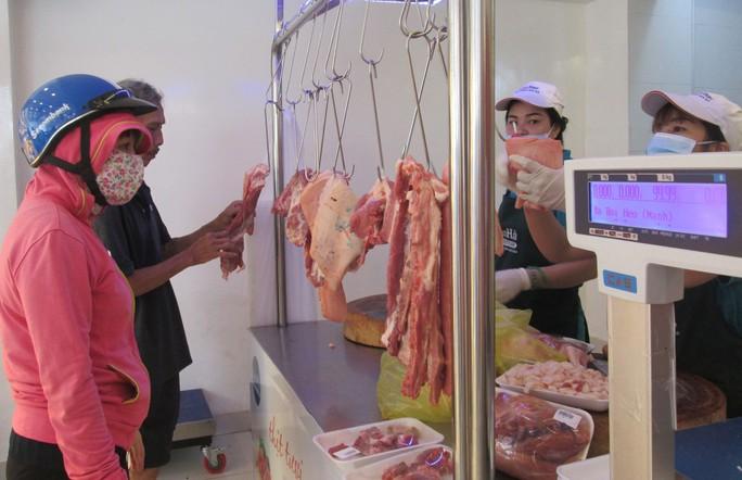 Giá thịt heo tăng nóng - Ảnh 1.