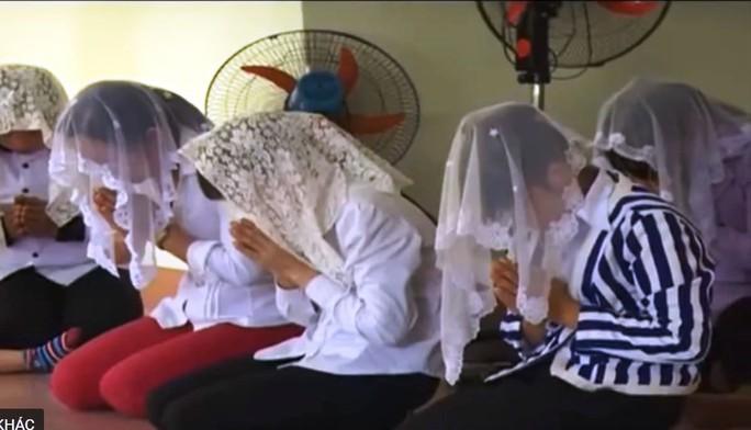 Xác định 2 đối tượng cầm đầu Hội thánh Đức Chúa Trời Mẹ ở Quảng Bình - Ảnh 1.