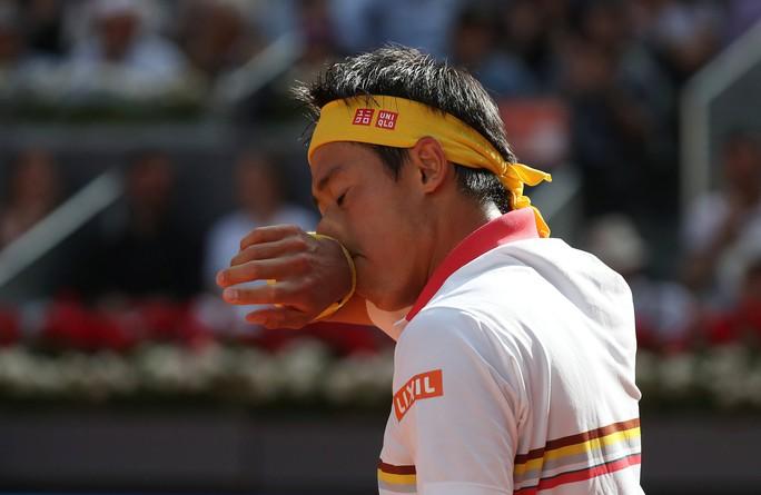 Djokovic lấy lại cảm hứng khi thắng Nishikori ở Madrid Open - Ảnh 2.