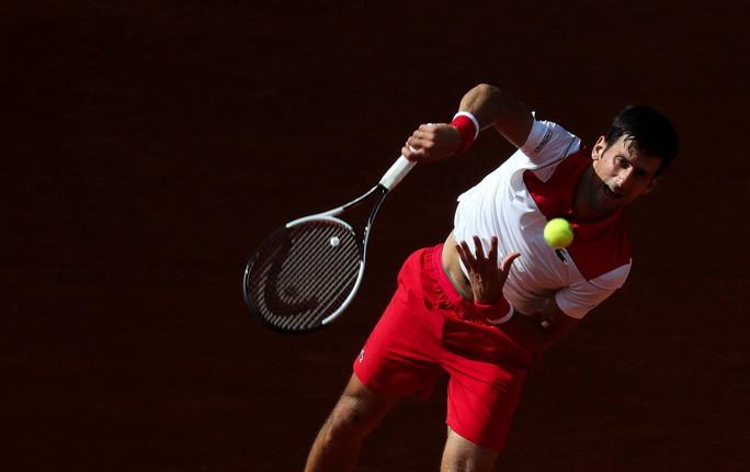 Djokovic lấy lại cảm hứng khi thắng Nishikori ở Madrid Open - Ảnh 1.
