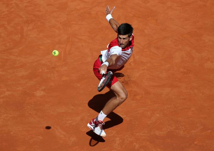 Djokovic lấy lại cảm hứng khi thắng Nishikori ở Madrid Open - Ảnh 3.
