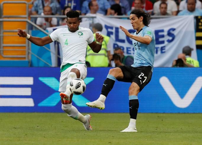Luis Suarez tỏa sáng, Uruguay cùng Nga vào vòng 1/8 - Ảnh 2.