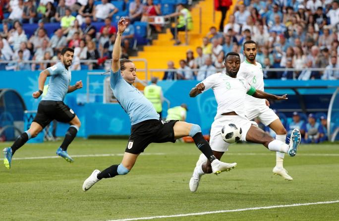 Luis Suarez tỏa sáng, Uruguay cùng Nga vào vòng 1/8 - Ảnh 4.