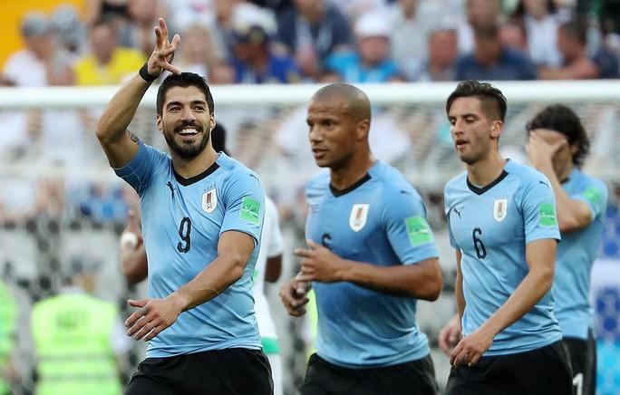 Luis Suarez tỏa sáng, Uruguay cùng Nga vào vòng 1/8 - Ảnh 6.