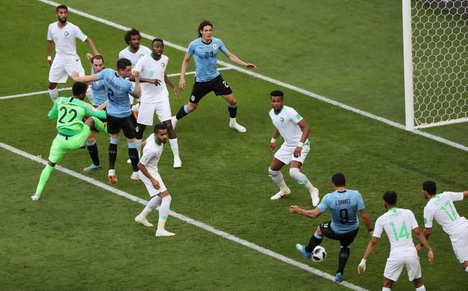 Luis Suarez tỏa sáng, Uruguay cùng Nga vào vòng 1/8 - Ảnh 5.