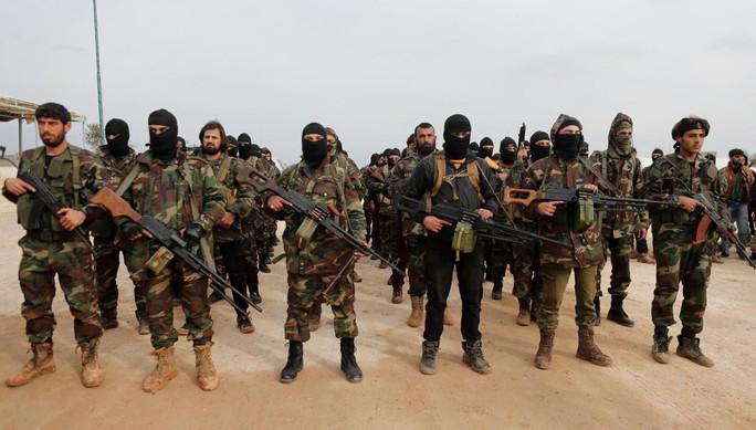 """Mỹ """"bỏ rơi"""" phiến quân, Nga không kích Nam Syria? - Ảnh 1."""