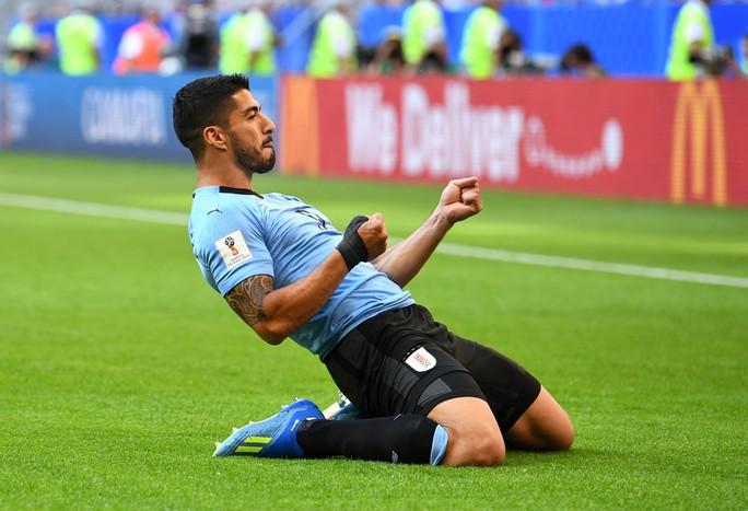 Suarez lập công, Uruguay đứng đầu bảng A - Ảnh 7.