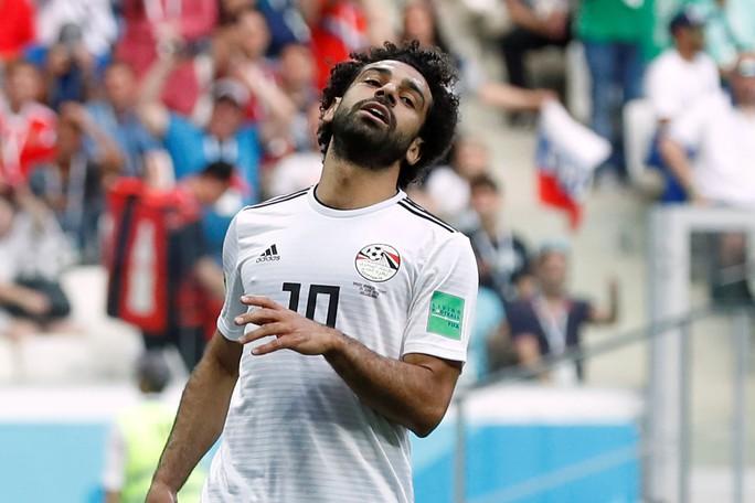 Suarez lập công, Uruguay đứng đầu bảng A - Ảnh 11.