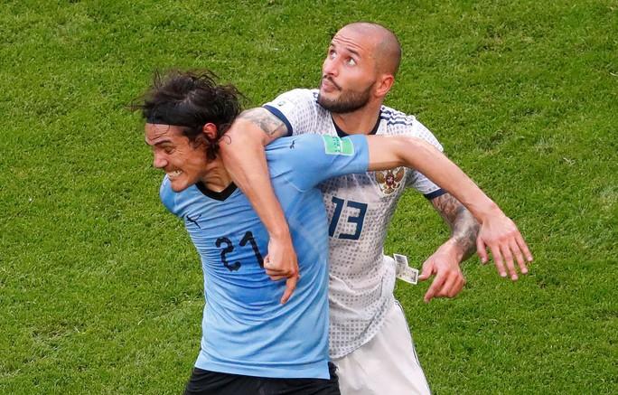 Suarez lập công, Uruguay đứng đầu bảng A - Ảnh 4.