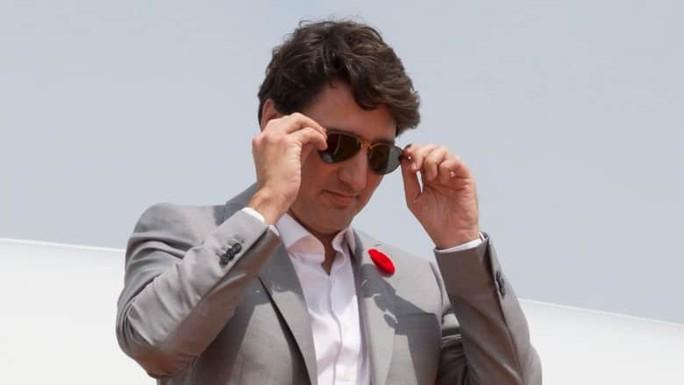 Vì 2 cặp kính mát, thủ tướng Canada bị phạt  - Ảnh 1.