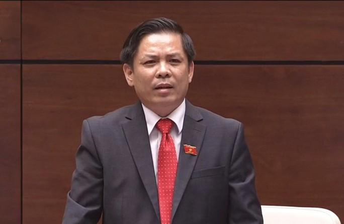 Bộ trưởng GTVT Nguyễn Văn Thể lần đầu ngồi ghế nóng trả lời chất vấn - Ảnh 1.