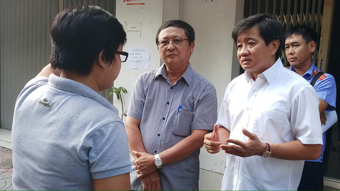 Cưỡng chế chung cư 60 tuổi ở trung tâm Sài Gòn - Ảnh 2.