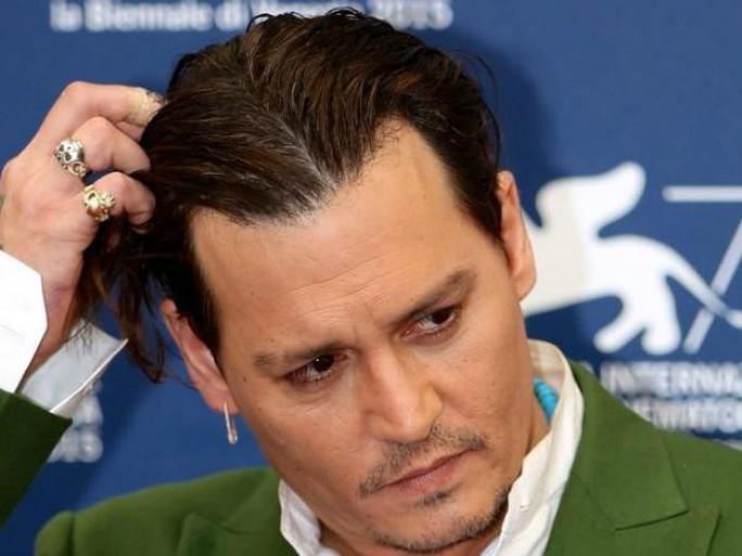 Cướp biển Johnny Depp dàn xếp êm vụ kiện 25 triệu USD - Ảnh 1.