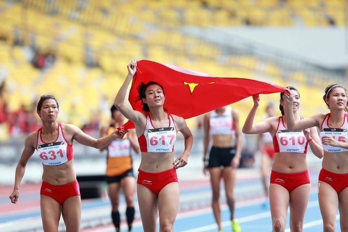 Tuyển tiếp sức 4x100 m nữ mất suất dự ASIAD 2018 - Ảnh 1.
