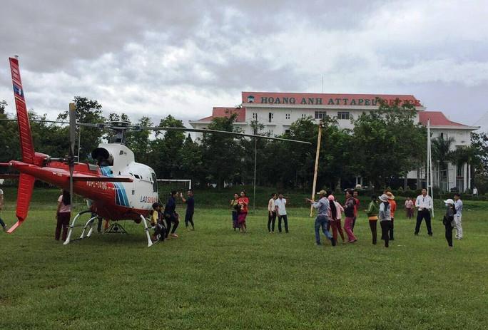 HAGL giải cứu 26 người mắc kẹt trong vụ vỡ đập thủy điện ở Lào - Ảnh 2.