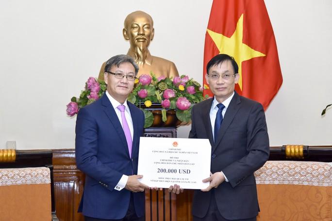 Vụ vỡ đập ở Lào: Đến ngày 26-7, chưa phát hiện người Việt mất tích - Ảnh 1.
