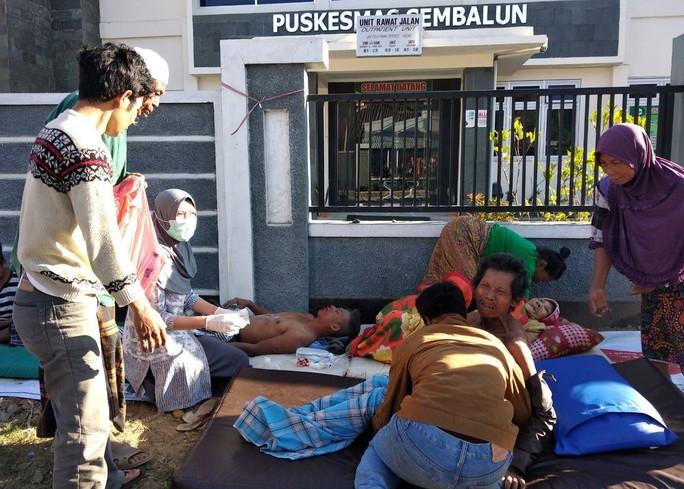 Indonesia: Đảo du lịch trúng động đất mạnh, 50 người thương vong - Ảnh 1.