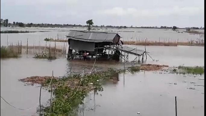 Miền Tây bắt đầu chống chọi với nước lũ từ sự cố vỡ đập ở Lào - Ảnh 1.