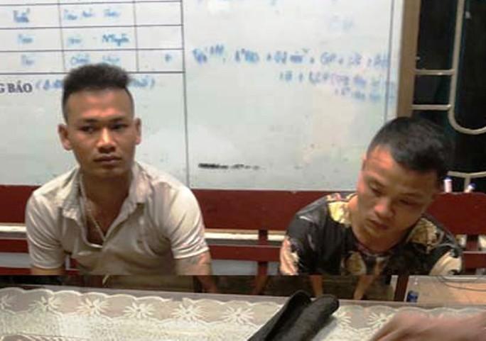 Bắt 2 thanh niên mang súng hoa cải nghi đi đòi nợ thuê dịp World Cup - Ảnh 1.
