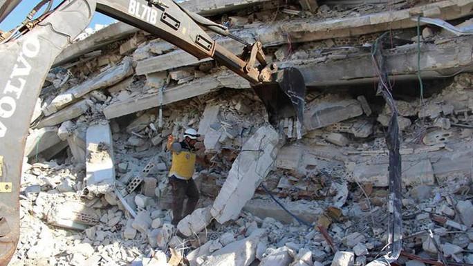 Syria: Nổ hầm vũ khí, 39 người thiệt mạng - Ảnh 3.