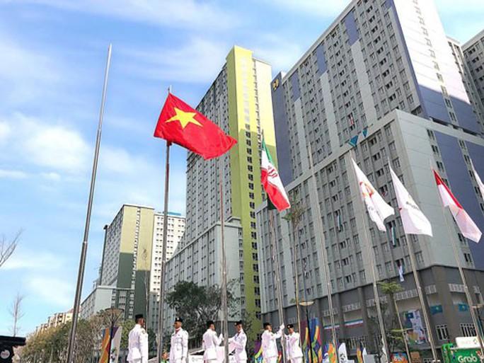 Quốc kỳ Việt Nam tung bay ở ASIAD 18 - Ảnh 1.