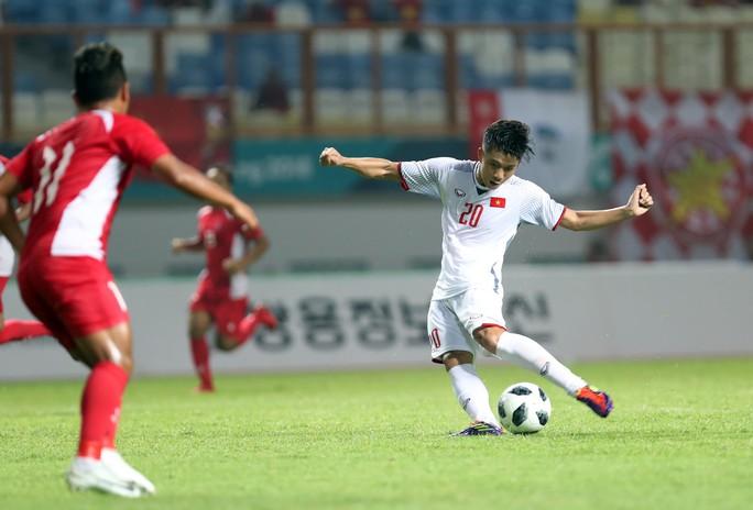 Olympic Việt Nam vào vòng 2, tranh ngôi đầu với Nhật - Ảnh 1.