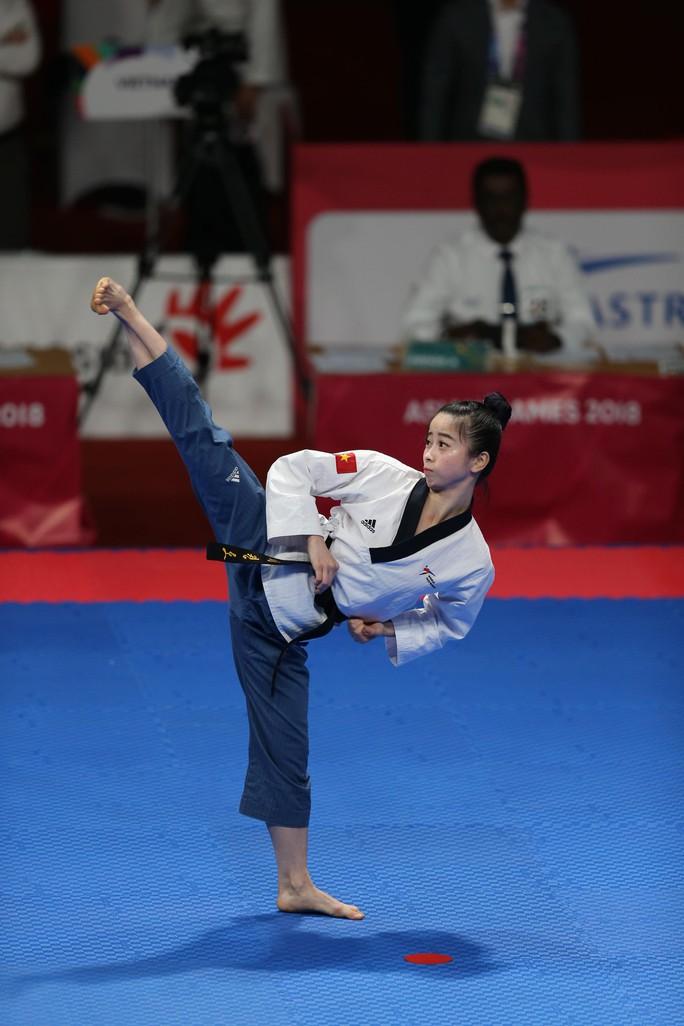 ASIAD: Ngày đẹp của bóng đá; taekwondo, bắn súng giành 2 HCĐ - Ảnh 4.