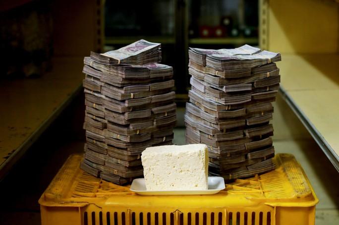 Mất giá khủng như tiền Venezuela: 1 kg thịt giá 9,5 triệu bolivar! - Ảnh 8.