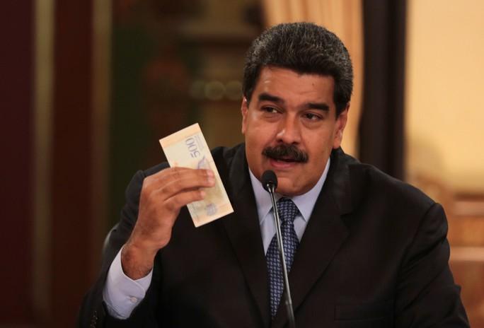 Mất giá khủng như tiền Venezuela: 1 kg thịt giá 9,5 triệu bolivar! - Ảnh 1.