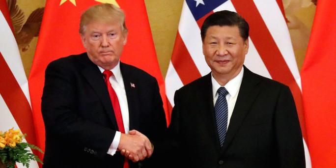 Ông Trump vừa đấm, vừa xoa Trung Quốc - Ảnh 1.