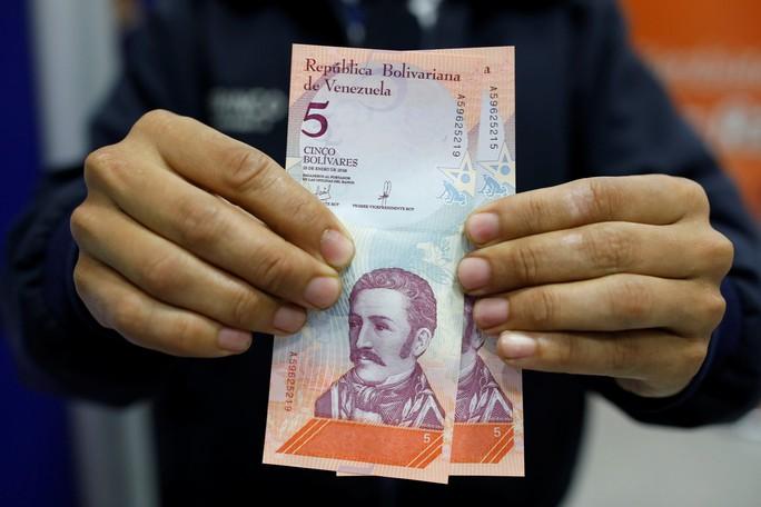 Venezuela tê liệt vì tiền mới - Ảnh 1.
