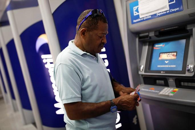 Venezuela tê liệt vì tiền mới - Ảnh 2.