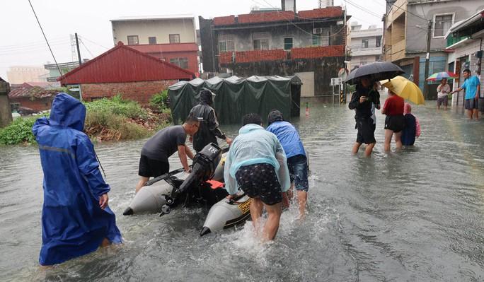 Trung Quốc cháy lớn, Đài Loan lụt sâu - Ảnh 8.