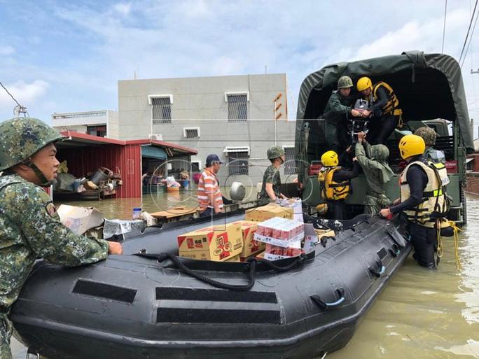 Trung Quốc cháy lớn, Đài Loan lụt sâu - Ảnh 6.