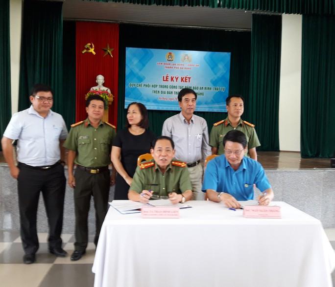 LĐLĐ TP Đà Nẵng và Công an ký kết Quy chế phối hợp an ninh trật tự - Ảnh 1.