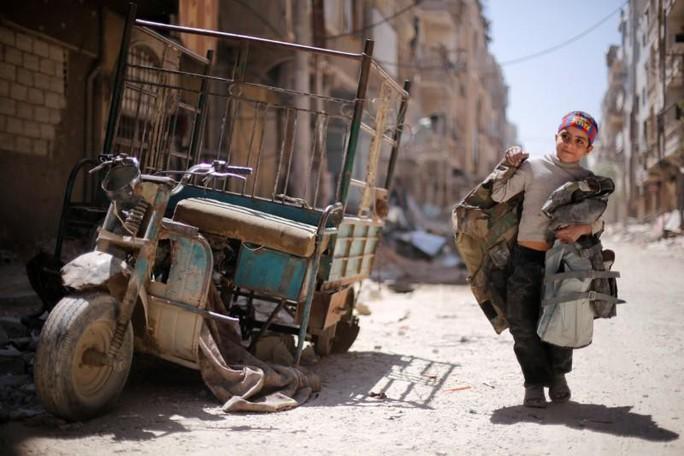 Nga đề nghị hợp tác tái thiết Syria, Mỹ phản ứng lạnh lùng - Ảnh 1.