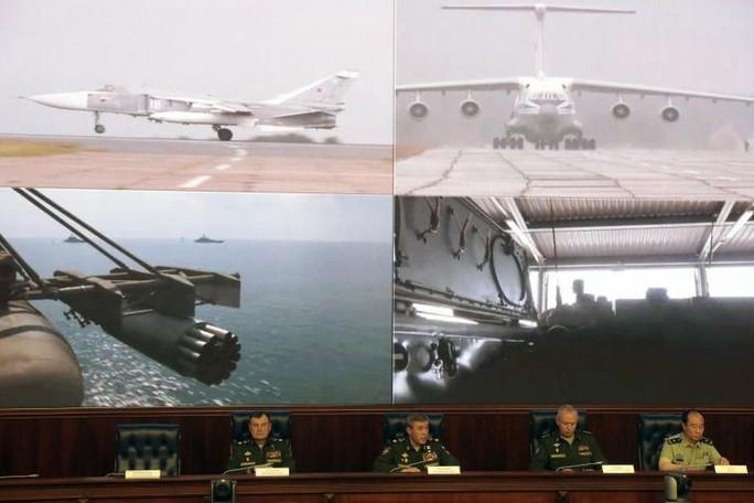 Ông Putin gặp ông Tập ngay lúc Nga khai màn tập trận khủng - Ảnh 2.