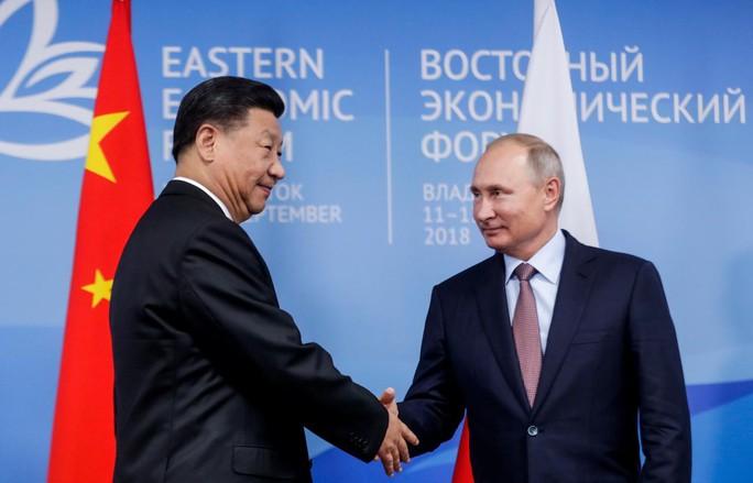 Ông Putin gặp ông Tập ngay lúc Nga khai màn tập trận khủng - Ảnh 1.