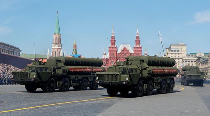 Mỹ trừng phạt Nga, Trung Quốc dính đòn - Ảnh 1.