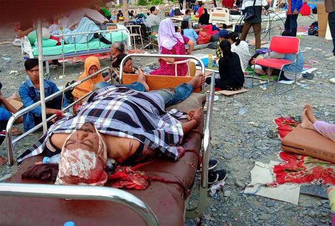 Động đất, sóng thần ở Indonesia: Số người chết tăng vọt lên gần 400 - Ảnh 8.